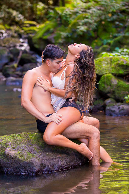 A couple kissing on a rock
