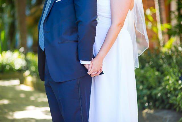 The bride and groom holding hands at the Santa Barbara Courthouse.