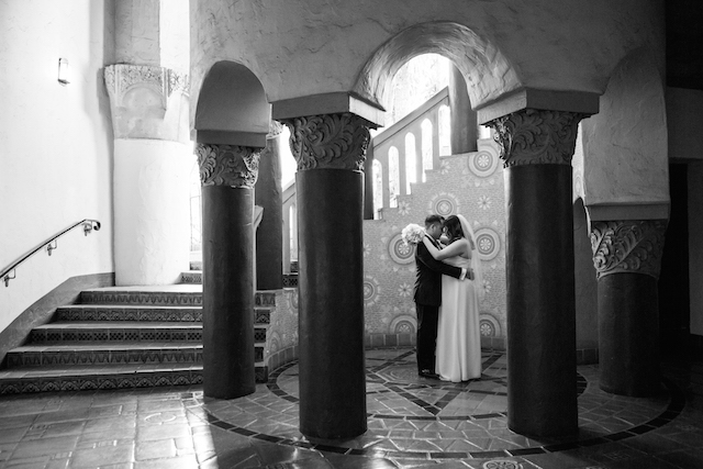 Married couple poses at the Santa Barbara Courtho