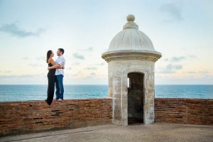Bride and groom watching the sunset from Castillo de San Cristobal in San Juan, Puerto Rico.