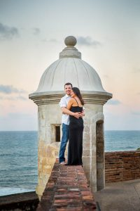 Bride and groom watching the sunset from Castillo San Cristobal in San Juan, Puerto Rico.