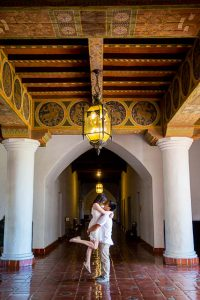 Bride and groom holding each other inside the Santa Barbara Courthouse.