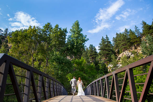 Couple walking on a bridge in Boulder, Colorado.