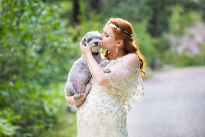 Bride holding her dog during her Boulder, Colorado, wedding.