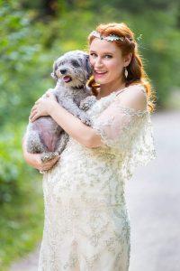 Bride holding her dog during her Boulder, Colorado, wedding.