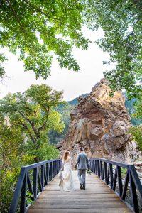 Bride and groom walking together during their Boulder, Colorado, destination wedding photoshoot.