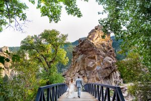 Bride and groom walking together during their Boulder, Colorado, destination wedding photoshoot.