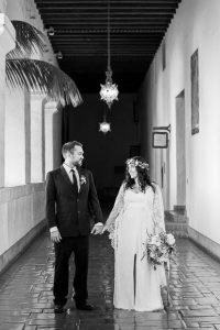 Newlywed couple walking around the interior of the Santa Barbara Courthosue.