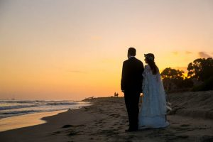 Bride and groom unset photos at Butterfly Beach in Santa Barbara.