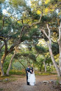 Newlyweds walking around at Ennisbrook trails.