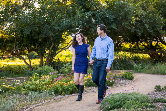 Engaged couple walking around Alice Keck Park in Santa Barbara, Califronia.