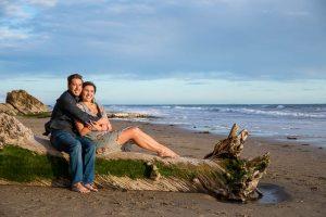 Couple hugging at their Hendry's Beach engagement photoshoot in Santa Barbara, CA.