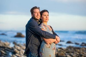 Couple hugging at their Hendry's Beach engagement photoshoot in Santa Barbara, CA.