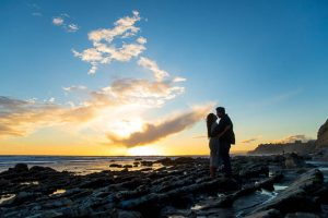 Sunset photos of engaged couple at Hendry's Beach.