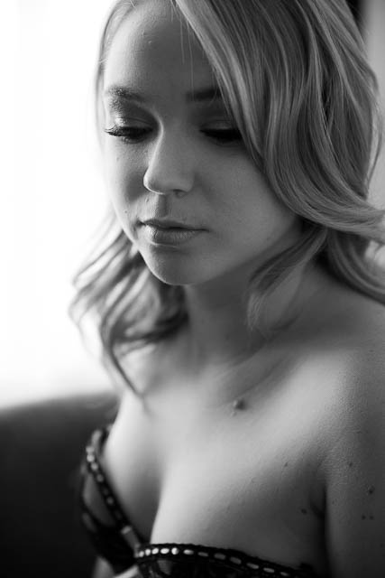 A black and white portrait of a blonde woman during her boudoir photoshoot in Los Angeles.