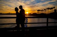 A silhouette of the bride and groom at Goleta Beach Pier.