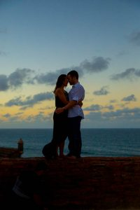 Sunset silhouette engagement photos at Castillo de San Cristobal, San Juan, Puerto Rico.