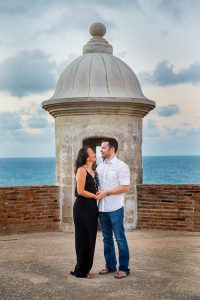 The couple holding each other during their engagement photos at the Castillo San Cristobal in Old San Juan, Puerto Rico.