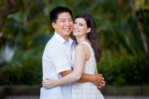 Engaged couple walking together around the Santa Barbara Courthouse grounds.