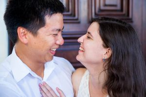 Couple holding each other during Santa Barbara Courthouse engagement photos.