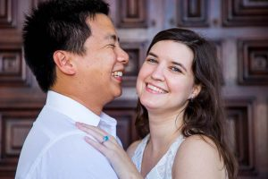 Bride and groom smiling at the Santa Barbara Courthouse.
