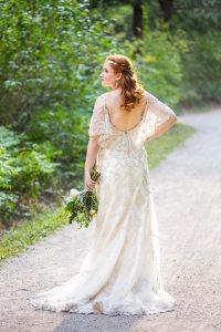 Bride posing on a trail in Boulder, Colorado.
