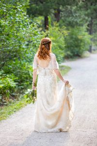 Bride posing on a trail in Boulder, Colorado.