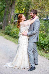 Bride and groom embracing during their Boulder, Colorado, destination wedding photoshoot.