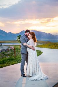 Sunset photos overlooking the Colorado Rockies with bride and groom.