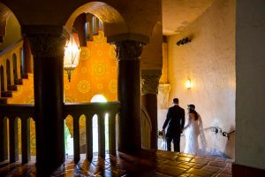 Bride and groom walking around the Santa Barbara Courthouse after their wedding ceremony.