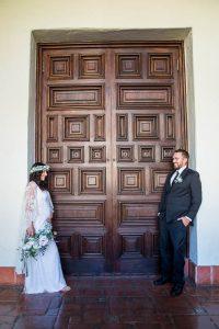 Newlywed couple walking around the interior of the Santa Barbara Courthosue.