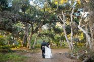Newlyweds walking around at Ennisbrook trails.