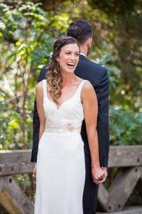 Bride and groom prepare for their first look at Glen Annie Golf Club in Goleta, CA.