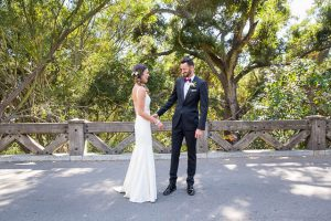 Bride and groom prepare for their first look at Glen Annie Golf Club in Goleta, CA.