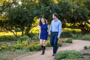 Engaged couple walking around Alice Keck Park in Santa Barbara, Califronia.