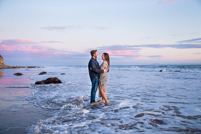 Bride and groom in the water during sunset at Hendry