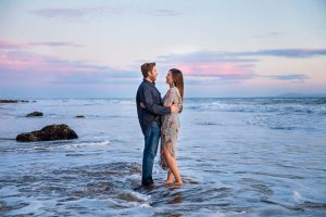 Bride and groom in the water during sunset at Hendry's Beach in Santa Barbara.