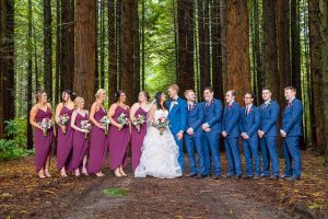 Bride and groom with their wedding party during their Rotorua New Zealand wedding.