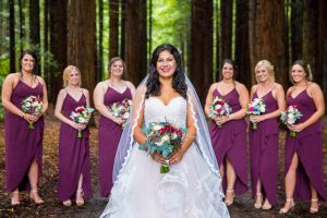 The bride with her bridesmaids at her Rotorua Redwoods in New Zealand wedding.