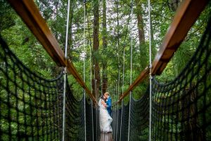 The bride and groom hugging on a bride at the Rotorua Redwoods Treewalk.