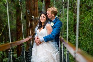 Newlyweds holding each other at the Rotorua Redwoods Treewalk.