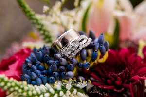 Photos of the wedding rings in the bridal bouquet during the Rotorua New Zealand wedding.