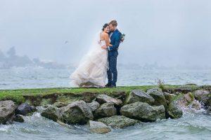 The newlyweds taking photos at Lake Rotorua, New Zealand, on a rainy day.