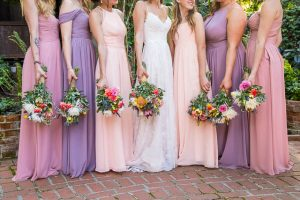 Bride and bridesmaids in the Ojai The Ranch House courtyard.