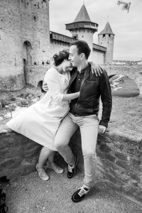 Newlyweds embracing during their wedding photographs in France, taken by LA-based destination wedding photographer, Karen D Photography.