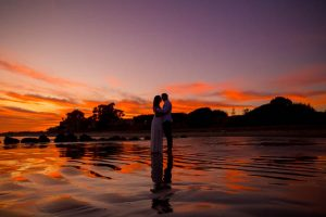 A silhouette photo of a couple during their engagement photoshoot at the beach in Santa Barbara, California.