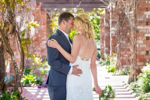 Bride and groom portraits at the Belmond El Encanto lilly pond.