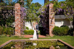Groom and bride portraits at the Belmond El Encanto Lilly pond wedding.