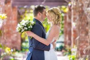 Bride and groom snuggling at their Belmond El Encanto hotel wedding.