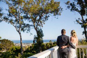 Bride and groom overlooking the ocean view from the Belmond El Encanto Dinning Room Restaurant.